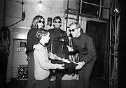U.N.C.L.E. agents attend the first U.N.C.L.E. Conference and Film Show at the Adelphi Cinema as guests of Smiths Potato Crisps. Chief Operative Nelson Smith presents an U.N.C.L.E. kit to 10 year old Agent Thomas McManus, Manor Street, Dublin.  Also picttured are Agents Tuesday and Montague Samson. Agent McManus won the kit in a special draw at the conference..01.04.1967