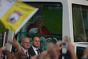 Pope Benedict XVI rides in his Popemobile through streets of Westminster during his papal tour of Britain 2010, the first visit by a pontiff since 1982. Taxpayers footed the £10m bill for non-religious elements, which largely angered a nation still reeling from the financial crisis. Pope Benedict XVI is the head of the biggest Christian denomination in the world, some one billion Roman Catholics, or one in six people. In Britain there are about five million Catholics but only a quarter of Catholics regularly attend Sunday Mass and some churches have closed owing to spending cuts.