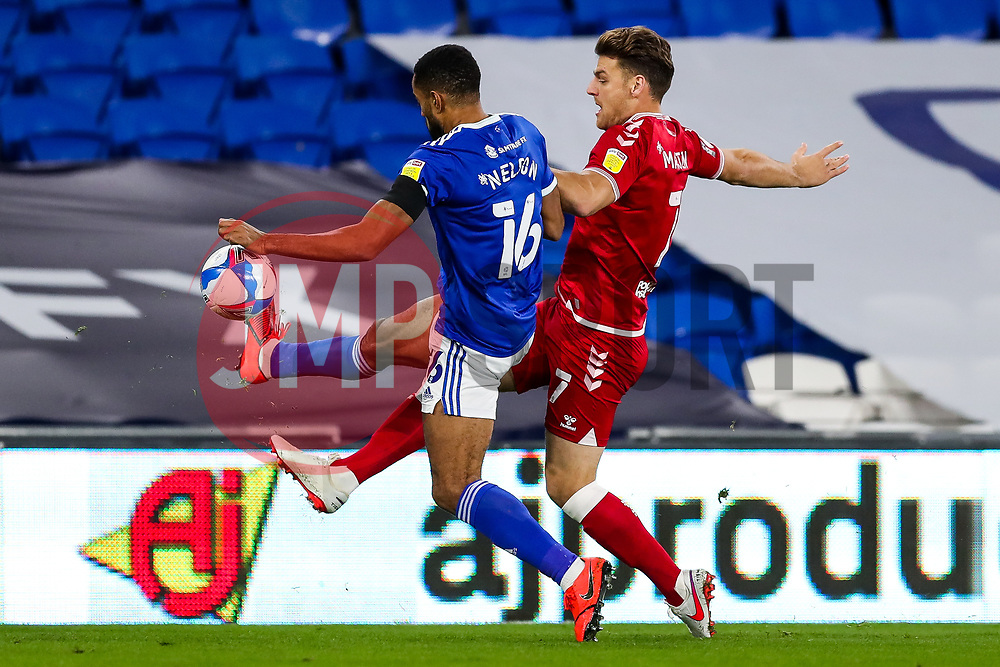 Chris Martin of Bristol City is challenged by Curtis Nelson of Cardiff City - Rogan/JMP - 06/11/2020 - Cardiff City Stadium - Cardiff, Wales - Cardiff City v Bristol City - Sky Bet Championship.