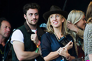 Sam Taylor-Wood and husband Aaron Taylor-Johnson watch the Black Keys.The 2014 Glastonbury Festival, Worthy Farm, Glastonbury. 29 June 2013.  Guy Bell, 07771 786236, guy@gbphotos.com