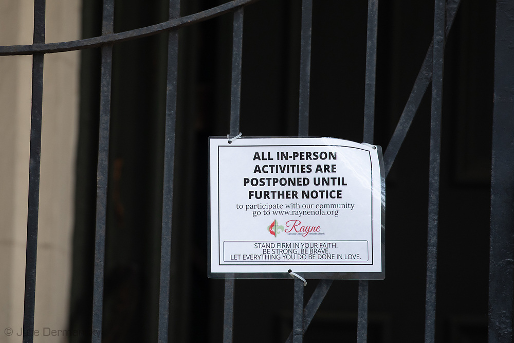 Sign on a church in New Orleans that is closed due to the coronavirus pandemic.