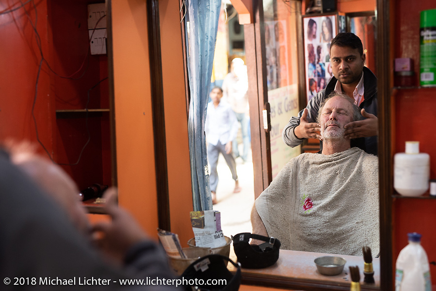 Jonathan Pite gets an amazing Nepalese haircut (that always seems to include quite the massage) in Kathmandu after our Himalayan motorcycling adventure, Nepal. Friday, November 16, 2018. Photography ©2018 Michael Lichter.