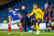 Thorgan Hazard (#16) of Belgium takes on Ryan Fraser (#2) of Scotland during the International Friendly match between Scotland and Belgium at Hampden Park, Glasgow, United Kingdom on 7 September 2018.
