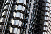 Detail of the Lloyds Building in the City of London. The Lloyd's building (also sometimes known as the Inside-Out Building) is the home of the insurance institution Lloyd's of London, and is located at 1, Lime Street. It was designed by architect Richard Rogers and built between 1978 and 1986. The building was innovative in having its services such as staircases, lifts, electrical power conduits and water pipes on the outside, leaving an uncluttered space inside.