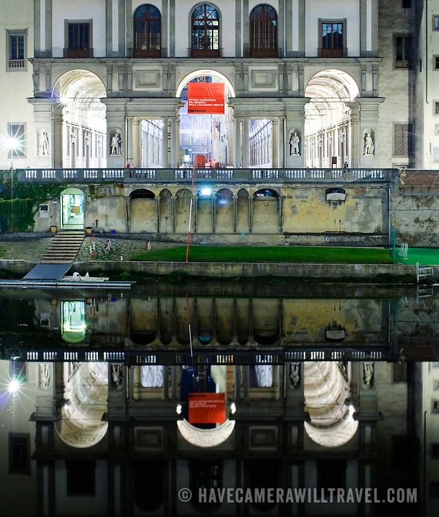 Galleria degli Uffizi at night reflected on the Arno River