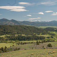 Lenticular clouds hover over Montana's Gallatin Valley and Gallatin Range, viewed from the southern Bridger Mountains.