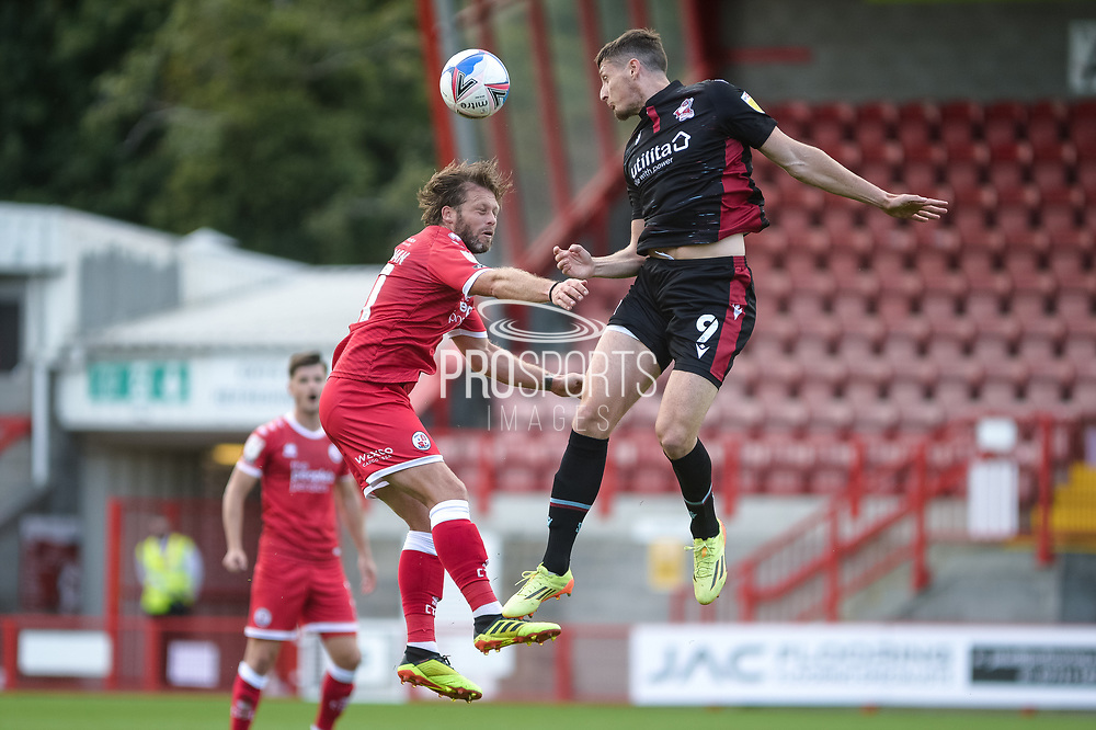 Ryan Loft (9) of Scunthorpe United and Dannie Bulman of Crawley Town battles for possession with during the EFL Sky Bet League 2 match between Crawley Town and Scunthorpe United at The People's Pension Stadium, Crawley, England on 19 September 2020.