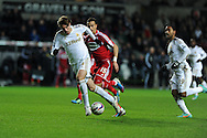 Swansea city's Michu makes a break. Capital one cup, quarter final, Swansea city v Middlesbrough at the Liberty Stadium in Swansea, South Wales on Wednesday 12th Dec 2012. pic by Andrew Orchard, Andrew Orchard sports photography,