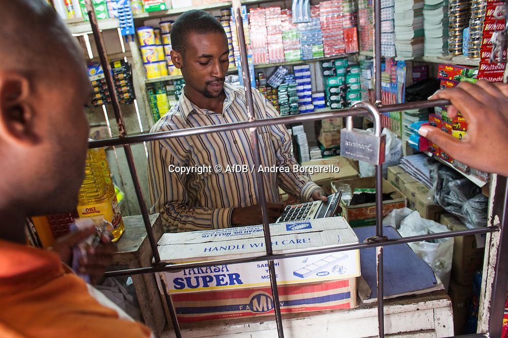 John, food shop, is an Access Bank Tanzania Micro Credit Client.