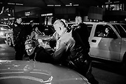 11122016 - Indianapolis, Indiana, USA: Indianapolis police arrest two woman who were protesting against Trump and blocking traffic. Anti-Trump protesters held signs against United States president elect Donald Trump, and his running mate vice president elect Mike Pence. The protesters who ranged from muslims, Black Lives Matter activists, members of the LGBTQ community, and others, are angry about the policies proposed by Trump, and that he was not elected by the popular vote, but will be elected by the electoral college. Seven protesters were arrested during the march, and at one point police used rubber bullets and pepper balls against marchers while running through the group on horseback. Police later gave an order to disperse, and protesters continued to protest at the Indianapolis Circle Center near the Indiana Statehouse where Mike Pence served as Indiana governor. Two police officers were slightly injured by protesters throwing rocks.