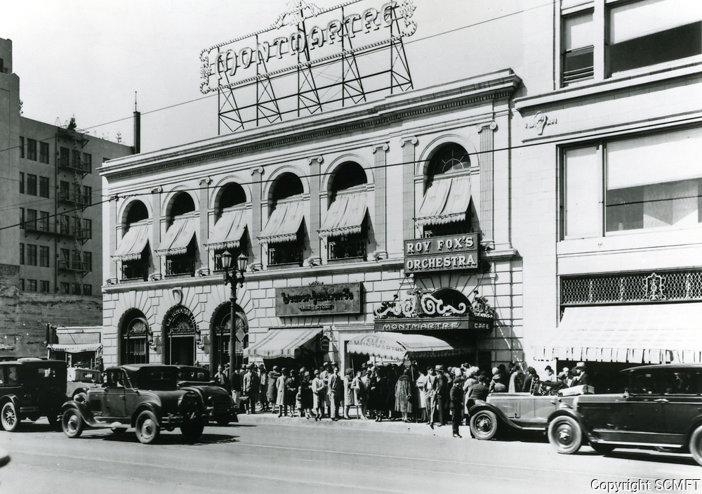 1929 Fans waiting to see celebrities enter the Cafe Montmarte on Hollywood Blvd.