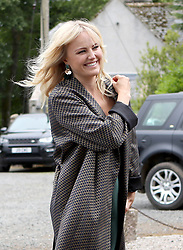 Actress Malin Akerman arrives at Rayne Church, Kirkton of Rayne in Aberdeenshire, for the wedding ceremony of Game Of Thrones stars Kit Harington and Rose Leslie.