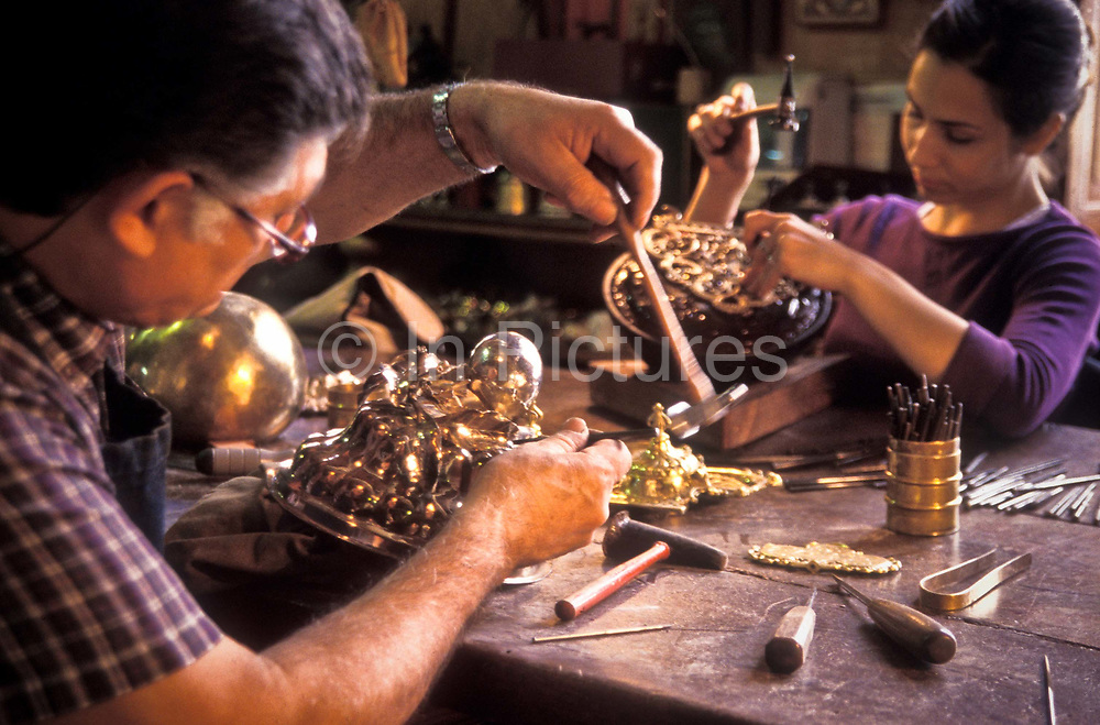Two Silversmith etch their many years experience into the making of elaborate Silver tableware objects from Buenos Aires' most famous Silversmith family, the Pallarols originally from Catalunya, Spain.