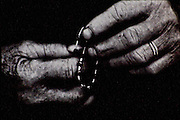 a woman with a rosary