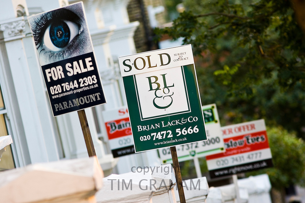 For Sale and Sold signs, West Hampstead, London, UK