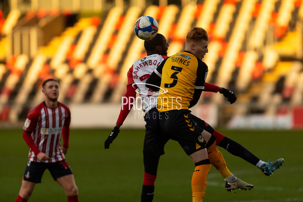 Newport County's Ryan Haynes (3) battles for possession with Oldham Athletic's Dylan Baham Boula (24) during the EFL Sky Bet League 2 match between Newport County and Oldham Athletic at Rodney Parade, Newport, Wales on 19 December 2020.