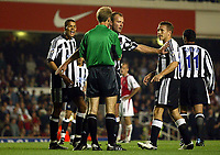 Photograph: Scott Heavey.<br />Arsenal v Newcastle United. FA Barclaycard Premiership. 26/09.2003.<br />Alan Shearer leads the Protests against the hand ball from Jermaine Jenas.