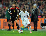 Demi Stokes of England Women is chased by Melanie Leupolz of Germany Women<br /> - Womens International Football - England vs Germany - Wembley Stadium - London, England - 23rdNovember 2014  - Picture Robin Parker/Sportimage