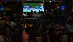 June 19, 2017 - Lahore, Punjab, Pakistan - Pakistani cricket fans watch the cricket final match between Pakistan and India at a shopping mall. The Champions Trophy final match between India and Pakistan is taking place at The Oval in London. (Credit Image: © Rana Sajid Hussain/Pacific Press via ZUMA Wire)