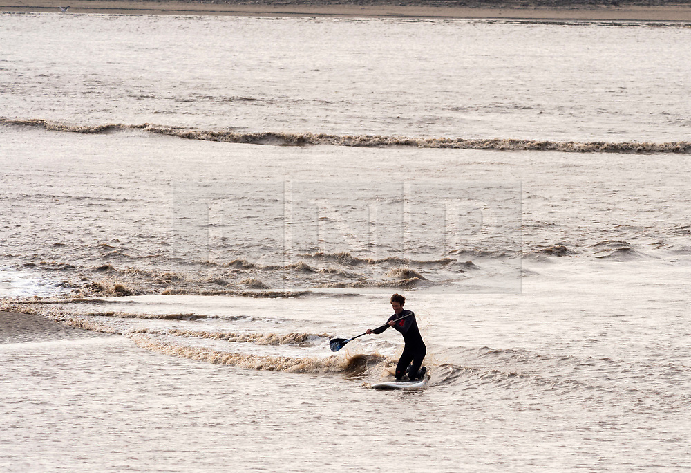 © Licensed to London News Pictures; 19/09/2020; Newnham, Gloucestershire, UK.Surfers ride the Severn Bore, a tidal surge on the river Severn which can reach 10m, depending on various weather factors and tide and river levels. Surfers and canoeists can travel miles up river on the bore. Photo credit: Simon Chapman/LNP.