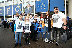 Leicester City fans showing their respect to Vichai Srivaddhanaprabha with their t-shirts outside the King Power Stadium
