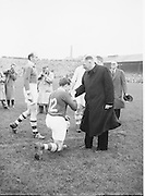 All Ireland Senior Football Final Replay. Meath v Cavan..Dr.Kyne with Meath Capt. P. Meegan..Winners - Cavan 0.9 - 0.5..12.10.1952  12th October 1952S. Morris, J. McCabe, P. Brady, D. Maguire, P. Carolan, L. Maguire, B. O'Reilly, V. Sherlock, T. Hardy, S. Hetherton, M. Higgins (Captain), E. Carolan, J. J. Cassidy, A. Tighe, J. Cusack. Note: P. Fitzsimons played in drawn game. J. Cusack came on for replay. P. Fitzsimmons was introduced as Sub for J. J. Cassidy in replay.