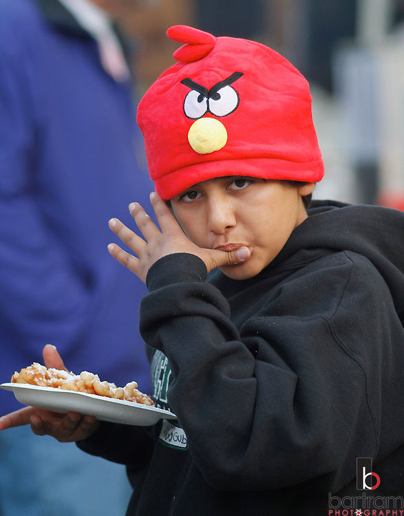 Photo by Kevin Bartram..Gabriel Vargas of Antioch enjoys a funnel cake at the Contra Costa County Fair in Antioch on Thursday, June 2, 2011.