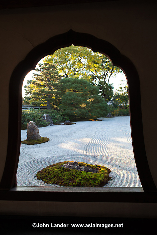 """Daioen Garden Window- To the south of the hojo at Kenninji Temple there is a dry or karesansui garden named """"Daioen"""" which means grand garden. It is said that the pattern of white gravel symbolizes a field of clouds.  This effect is helped by the waves and ripples in the gravel which give this effect."""