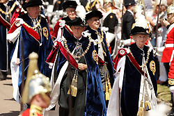 The two newest members, Lady Companion Dame Mary Fagan (centre) and Knight Companion The Viscount Brookeborough, (right) walk at the front of the procession to the annual Order of the Garter Service at St George's Chapel, Windsor Castle.