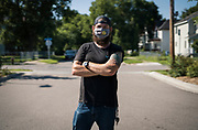 Pillsbury United Communities Food Systems Manager Ethan Neal poses for a portrait outside the Waite House Neighborhood Center in Minneapolis, Minnesota, U.S., on Friday, July 24, 2020. Photographer: Ben Brewer/Bloomberg