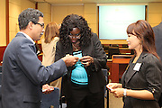 Prospective mentors and protégés exchange information at an information session last Thursday at Metro downtown.