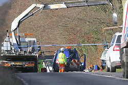Nether Wallop,Hampshire Tuesday 22nd November 2016 Two people have died following a collision near to the village of Nether wallop in Hampshire this morning .<br /> <br /> The collision involved a Blue VW Caddy Van and a White Citroen panel van and took place on the A30 near to Wallop Drive at around 6.50am on Tuesday morning. Police closed the road for over five hours this morning to carry out collision scene investigation work following the fatal collision<br /> <br /> Emergency services were called to the scene with paramedics and doctors in an attempted to save those involved. But sadly just before 11am two private ambulances where driven from the scene under Police escort.<br /> <br /> <br /> A specialist Hi-ab crane from Williams Garage was brought into recover one of the vehicle that came to rest in the tree line at the side of the A30.<br /> <br /> The single carriageway section of the A30 was closed the following a collision with drivers being diverted away from the scene.<br /> <br /> The road has since been cleared and reopened following the collision<br /> <br /> A spokeswoman from Wilts and Dorset Fire Control said that they sent two fire appliances to the scene after receiving  a  call just after 6.54am.©UKNIP