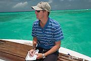 manta researcher Guy Stevens takes notes on numbers of manta rays, boats, snorkelers, and divers at Hanifaru Bay, Hanifaru Lagoon, Baa Atoll, Maldives ( Indian Ocean )