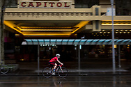 A bicyclist is seen braving the rain in Swanston Street during COVID-19 in Melbourne, Australia. Victoria has recorded 14 COVID related deaths including a 20 year old, marking the youngest to die from Coronavirus in Australia, and an additional 372 new cases overnight. (Photo by Dave Hewison/Speed Media)