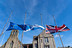 Edinburgh, Scotland, UK. 15 March., 2019. Flags flying at half mast outside Scottish Parliament building in Holyrood, Edinburgh in respect for those killed in terrorist attack on mosques in Christchurch , New Zealand.