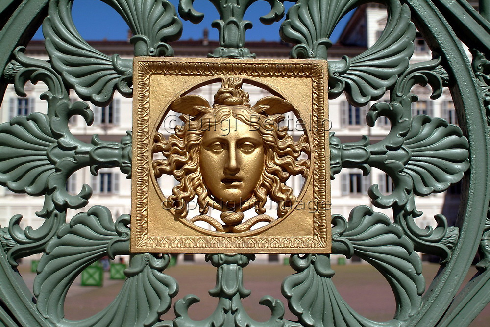 Turin, Pedmont, Italy particular of the gate of the Royal Palace with golden Medusa symbol embossed