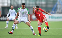 Republic of Ireland's Enda Stevens (left) and Gibraltar's Lee Casciaro (right) battle for the ball during the UEFA Euro 2020 Qualifying, Group D match at the Victoria Stadium, Gibraltar.