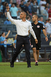 July 8, 2018 - Bronx, New York, United States - New York Red Bulls head coach CHRIS ARMAS waves to fans ahead of his first game with the team before a regular season match at Yankee Stadium in Bronx, NY.  New York City FC defeats the New York Red Bulls 1 to 0 (Credit Image: © Mark Smith via ZUMA Wire)