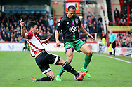 Brentford defender, Maxim Colin (2) tackling Bristol City striker, Peter Odemwingie (27) during the Sky Bet Championship match between Brentford and Bristol City at Griffin Park, London, England on 16 April 2016. Photo by Matthew Redman.