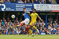 Portsmouth Forward, Oliver Hawkins (9) with a shot at goal Oxford United Defender, Curtis Nelson (5) during the EFL Sky Bet League 1 match between Portsmouth and Oxford United at Fratton Park, Portsmouth, England on 18 August 2018.