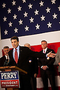 Republican presidential candidate Gov. Rick Perry speaks to veterans aboard the USS Yorktown museum on December 8, 2011 in Mt Pleasant, South Carolina.