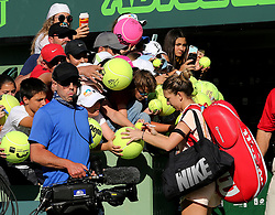 March 22, 2018 - Key Biscayne, FL, USA - Simona Halep of Romania signs autographs for fans after her 3-6, 6-3, 7-5 victory against Oceane Dodin of France in the first round of the Miami Open in Key Biscayne, Fla., on Thursday, March 22, 2018. (Credit Image: © Pedro Portal/TNS via ZUMA Wire)