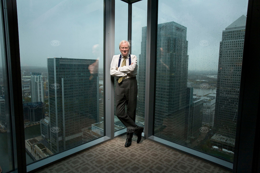 Photo ©2008 Tom Wagner,  ©Tom Wagner 2008, all rights reserved, all moral rights asserted. John Varley, CEO Barclays PLC, photographed in London and the company headquarters building in Canary Wharf area of London, with a view of the other skyscrapers of London (the area of London's tallest buildings--this shot is from the 31st floor/executive floor)..©Tom Wagner 2008, all rights reserved, all moral rights asserted..