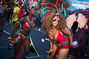 Female dancers show of their costumes and moves in the procession moving up the high street  in East London, United Kingdom,Sept 11 2016. The annual Hackney Carnival took place on a hot summers day and the procession of dancers dressed in various outfits moved through the streets to much joy of the many bystanders.