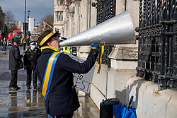 © Licensed to London News Pictures. 15/03/2021. London, UK. Campaigner Steve Bray uses a megaphone to shout at Parliament ahead of a debate on the anti-protest bill later today. The bill has come under scrutiny in the wake of the handling of the Sarah Everard vigils.. Photo credit: Ben Cawthra/LNP