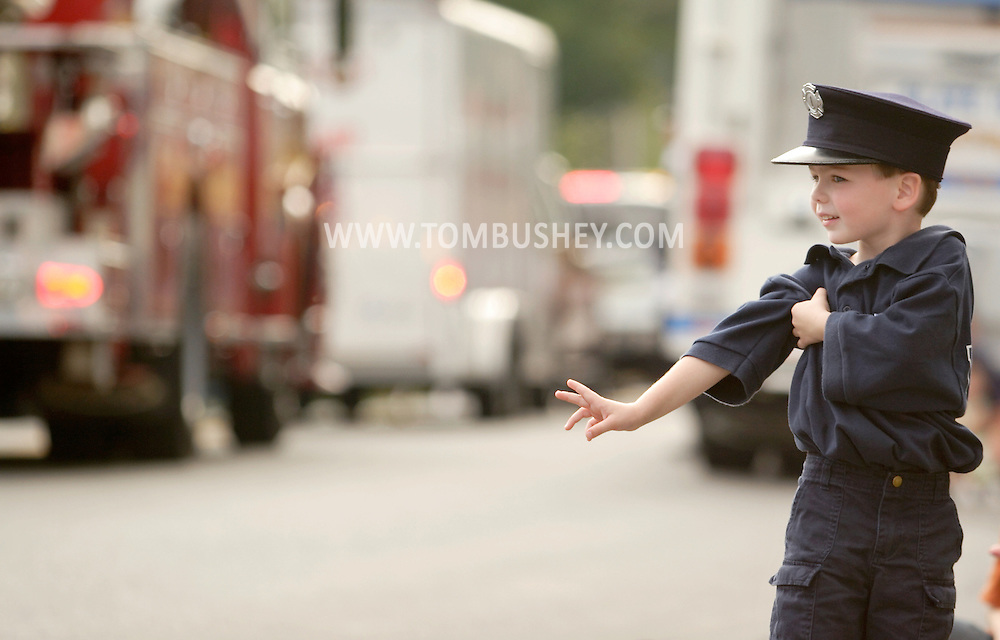 Middletown, N.Y. - A young boy wearing a firefighter's hat and an FDNY shirt watches the Middletown Fire Department's 147th Anniversary Fire Parade on Sept. 9, 2006. ©Tom Bushey