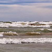 """""""Rolling Chaos""""<br /> <br /> Huge rolling waves and strong winds bring chaos to what would usually be a quiet day on Lake Michigan!!<br /> <br /> The Great Lakes by Rachel Cohen"""