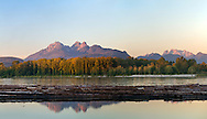 The Golden Ears mountains are a familiar sight from the Fraser Valley (especially Langley and Maple Ridge).  This view is photographed from Brae Island Regional Park in Langley, British Columbia with the Fraser River log booms in the foreground.  The Golden Ears (Mount Blanshard) consist of McPhaden Peak, Edge Peak and Blanshard Peak.  Mount Robbie Reid can be seen on the right.