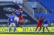 Cardiff City's Aden Flint (5) competes for a high ball with Nottingham Forest's Scott McKenna (26) during the EFL Sky Bet Championship match between Cardiff City and Nottingham Forest at the Cardiff City Stadium, Cardiff, Wales on 2 April 2021.