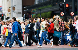 Pedestrians crossing street in central Glasgow Scotland